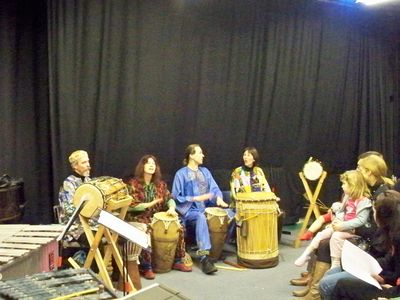 [ Bedford Djembe Group performing at The Arena Building, photo by Lee Stanley ]