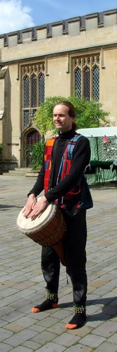 [ Malcolm with djembe outside Bedford's Harpur Centre ]