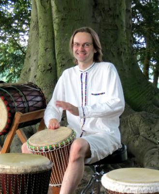 Malcolm playing djembe at Green Park in Summer 2012, photo by Mike Jackson