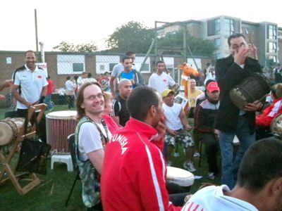 Malc jamming with ecstatic Tunisian master drummers at the West African Paralympics farewell party |
