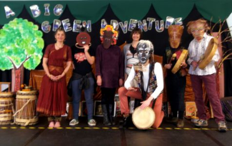 [ Masked facilitators onstage for a Carousel Day Wow Assembly - click to unmask! ]